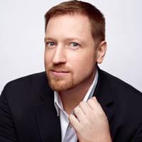 Professional headshot of David Cunic